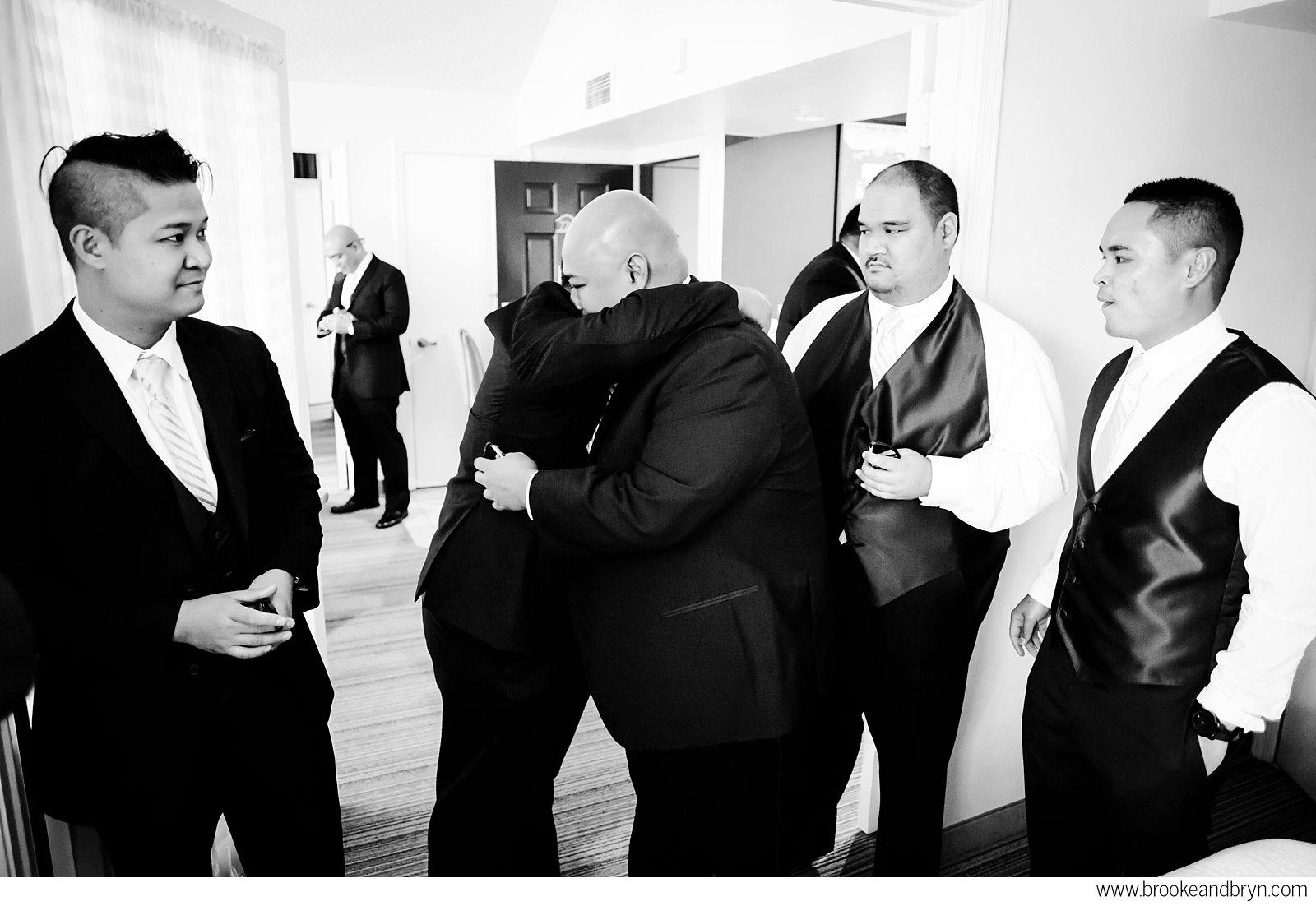 groomsman hug